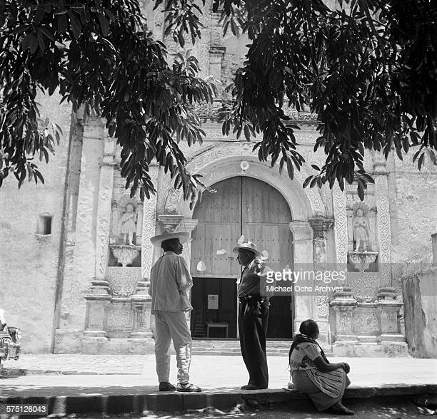 Local men stand outside Cuernavaca Cathedral in Cuernavaca Mexico