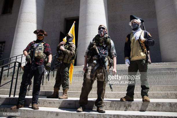 Local militia group is seen at a rally to protest the stay-at-home order amid the Coronavirus pandemic in Columbus, Ohio on April 20, 2020. - For the...