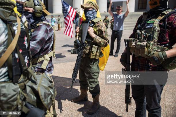 A local militia group is seen at a rally to protest the stayathome order amid the Coronavirus pandemic in Columbus Ohio on April 20 2020 For the...