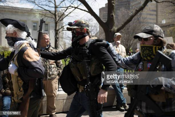 Local militia walks to the Ohio State House in Columbus, Ohio on April 18 to protest the stay home order that is in effect until May 1st.