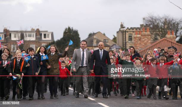 Local MP Nigel Adams Communities Secretary Sajid Javid and local school children on the reopened Tadcaster Bridge more than a year after its partial...