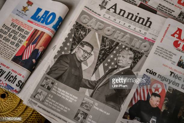 Local newspaper front pages show the news about the summit between US President Donald Trump and North Korean leader Kim Jongun on February 28 2019...