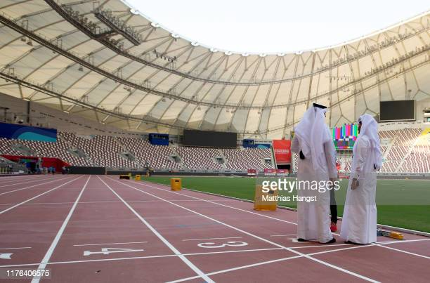 Local officials stand on the finish line inside the Khalifa International Stadium prior to the 17th IAAF World Athletics Championships Doha 2019 at...