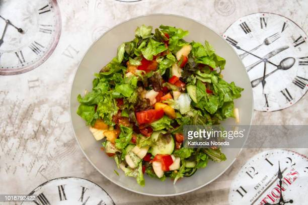 local overhead cuisine 775207810 - green salad stock pictures, royalty-free photos & images