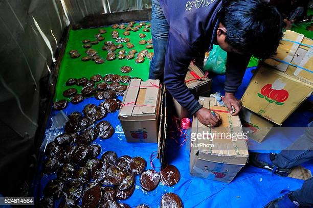 A Local packing molasses Chaku for final consuming on 06 January 2015 at Tokha Kathmandu Nepal for the celebration of Maghe Sankranti Festival...