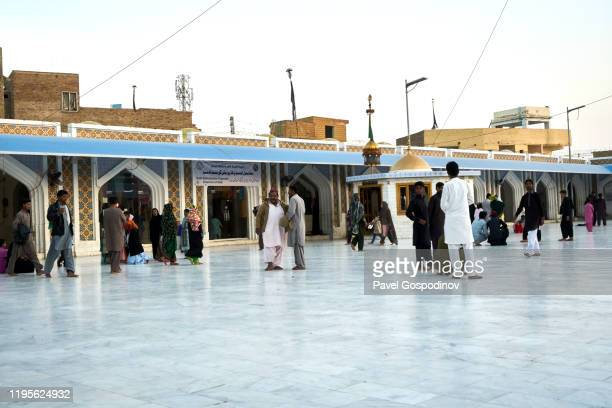 local pakistani people gathering in the inner yard of the lal shahbaz qalandar shrine in sehwan, pakistan - lal shahbaz qalandar stock pictures, royalty-free photos & images
