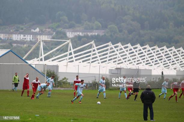Local park football match played in the shadow of the Liberty Stadium ahead of the Barclays Premier League match between Swansea City and Arsenal at...