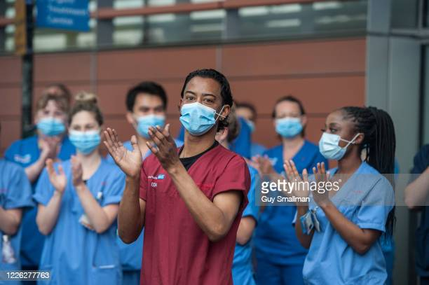 Local people and NHS workers applaud key workers at Royal London Hospital in East London. On May 14, 2020 in London, United Kingdom. Following the...