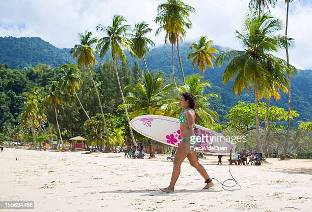Local people and tourists a girl with her surfboard take a bath sunbath or relax at Maracas Bay on October 21 2012 in Port of Spain Trinidad And...