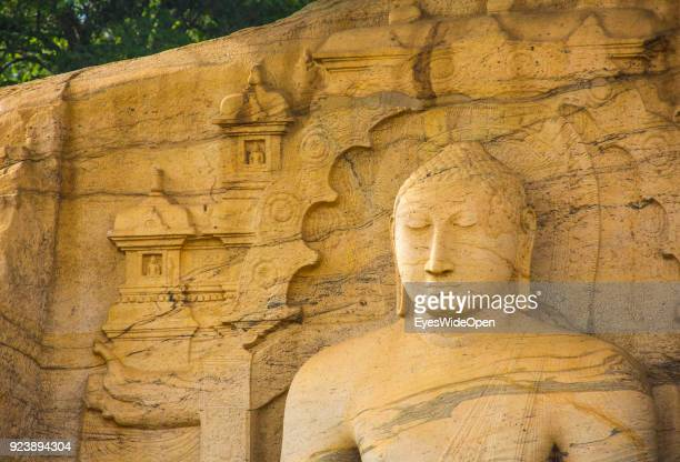 Local people and tourists visit the Gal Vihara the archeological park of the sacred city of Polonnaruwa the UNESCO World Heritage on February 19 2014...