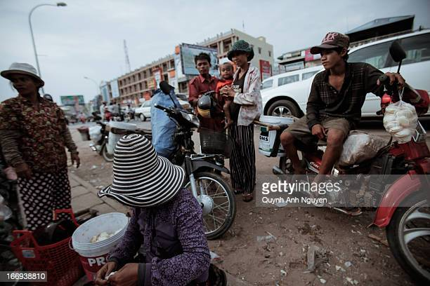 Local people and vendors near the open local market in Siem Riep, Cambodia