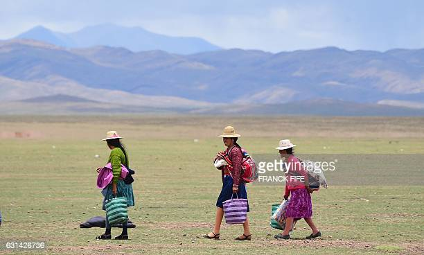 Local people are pictured during Stage 8 of the 2017 Dakar Rally between Uyuni in Bolivia and Salta in Argentina on January 10 2017 Wednesday's ninth...