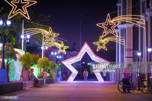 local people around roman catholic church of chanthaburi with light decorated - chanthaburi stock pictures, royalty-free photos & images