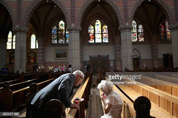 Local people attend a special mass in Saint Vitus Church in memory of the victims of Malaysia Airlines flight MH17 on July 20 2014 in Hilversum...
