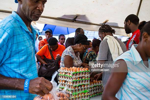 Local people buying eggs pupils and farmers buying and selling goods or sweets on a marketplace on October 21 2012 in Scarborough Trinidad And Tobago