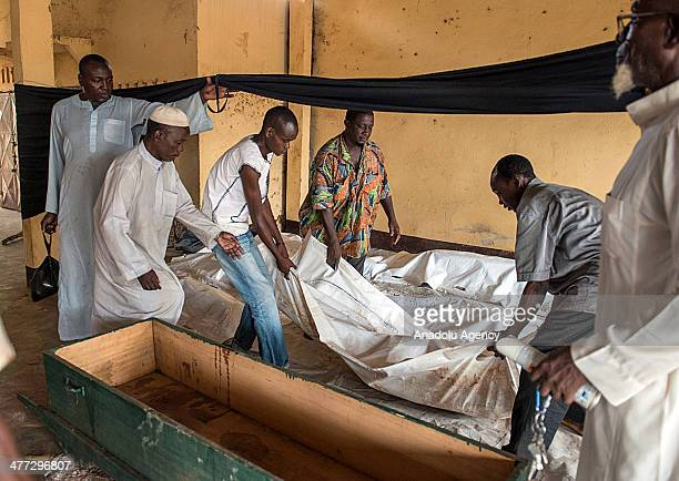 Local people carry a dead body during the funeral ceremony for 5 Muslims killed by Christian antibalaka militiamen in the capital Bangui Central...