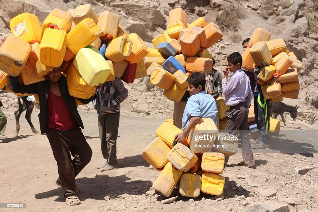 Local people carry the jerry cans filled up with water in Reif 17 km
