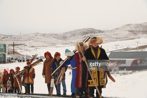 Local people carry their ancient fur skis before skiing at a ski resort on November 27 2019 in Altay Xinjiang Uyghur Autonomous Region of China Local...
