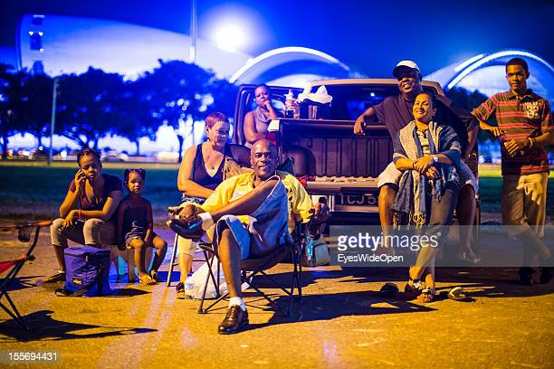 Local people family and friends have dinner together at a night market on October 21 2012 in Port of Spain Trinidad And Tobago In the background to...