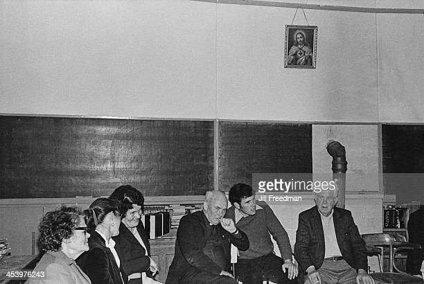 Local people gather with a priest to watch a band play at a schoolhouse in Ireland 1981