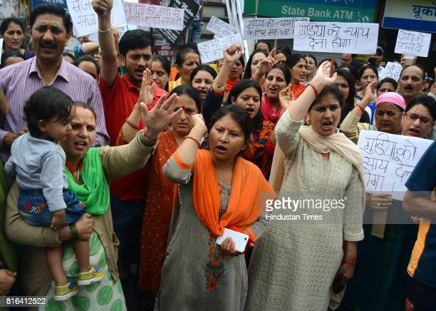 Local people hold a protest and chakkajam at BCS against rape and murder of teenage girl in Kotkhai on July 17 2017 in Shimla India Approx 99% voting...