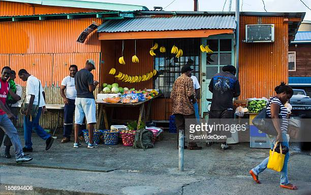 Local people in front of a fruit shop on October 21 2012 in Scarborough Trinidad And Tobago