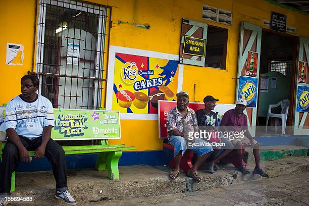 Local people in the smoking area in front of a groceries shop on October 21 2012 in Scarborough Trinidad And Tobago