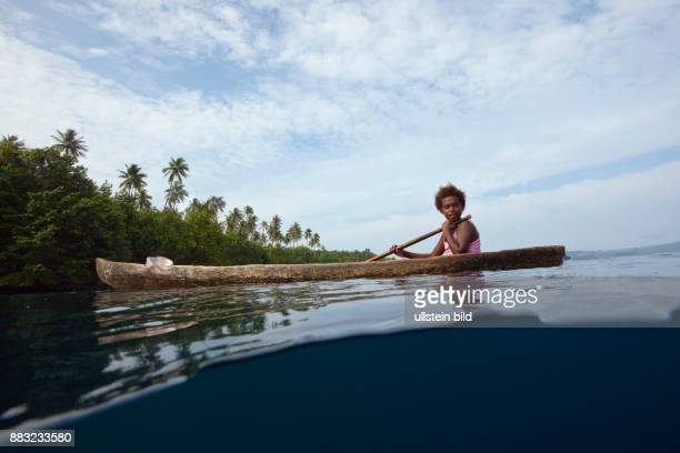 Local People in typical Dugout Canoe Florida Islands Solomon Islands