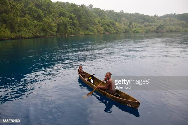 Local People in typical Dugout Canoe Russell Islands Solomon Islands