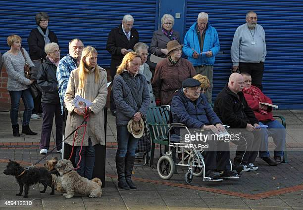 Local people listen to a memorial service for murdered British aid worker Alan Henning outside Eccles Parish Church on November 22 2014 in Manchester...