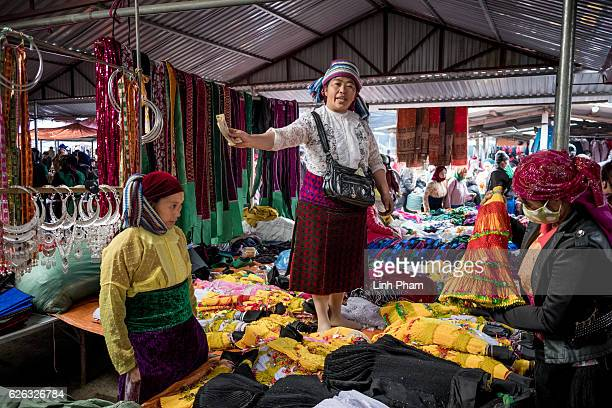 Local people mostly H'mong go shopping for clothes at Dong Van Sunday Market one of the furthest market up north near the border with China in the...