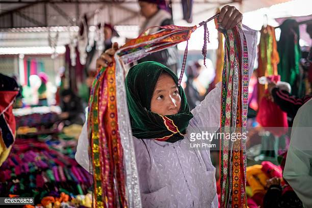 Local people mostly HÕmong go shopping for clothes at Dong Van Sunday Market one of the furthest market up north near the border with China in the...