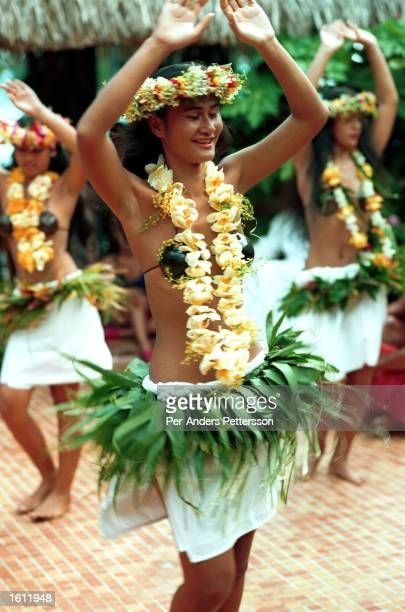 Local people perform a colorful traditional song and dance at a restaurant April 28 1997 on Bora Bora an island in French Polynesia The island is a...