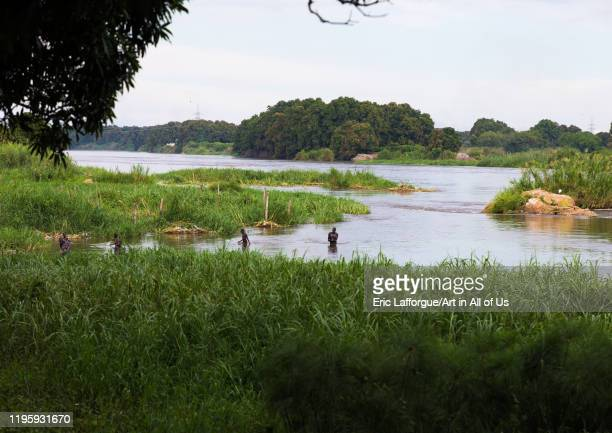 Local people playing in the waters of the white Nile river Central Equatoria Juba South Sudan on November 25 2019 in Juba South Sudan