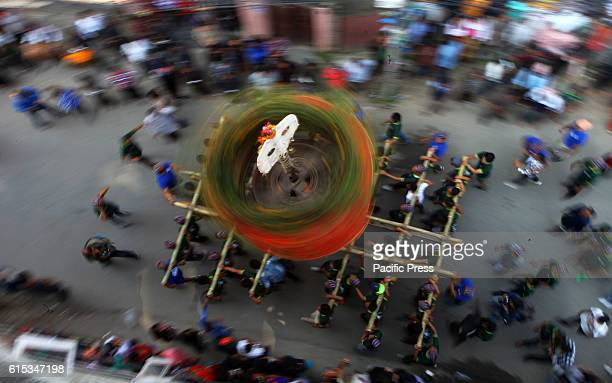 Local people rotate the traditional and unique chariot during Hadigaun festival which occurs after Dashain festival celebrated with unique upside...