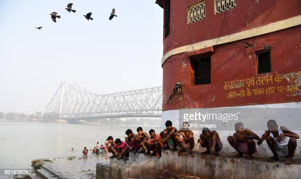 Local people seen brushing their teeth next to the Howrah bridge in Kolkata The Rabindra Setu also known as the Howrah bridge is a bridge with a...