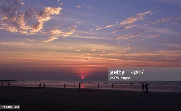 Local people seen enjoying Juhu Beach during the sunset in Mumbai