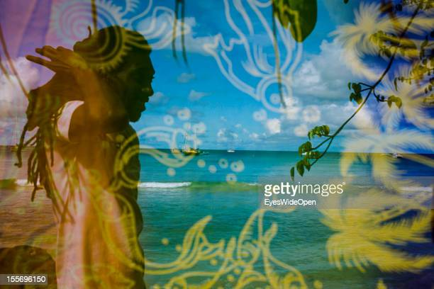 Local people selling knitted bikinis and scarfs along the beach with local sailing and fishing boats near pigeon point on October 21 2012 in...