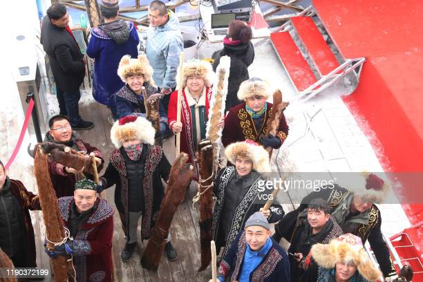 Local people show their ancient fur skis before skiing at a ski resort on November 27 2019 in Altay Xinjiang Uyghur Autonomous Region of China Local...