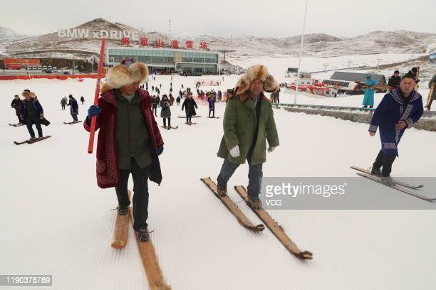 Local people ski with ancient fur snowboards at a ski resort on November 27 2019 in Altay Xinjiang Uyghur Autonomous Region of China Local herdsmen...
