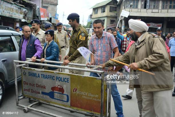 Local people stage chakkajam at Dhalli after the death of an accused of rape and murder of teenage girl in police custody on July 19 2017 in Shimla...