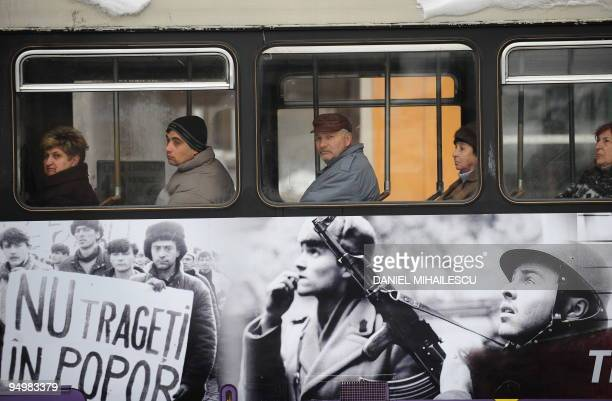 Local people travel on a tram decorated with pictures from 1989 Revolution in Timisoara city on December 17 2009 Scores of people on reenacted...