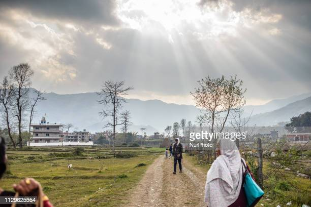 Local people walk along the road on the outskirts of Pokhara Nepal in March 2019