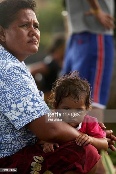 Local people watch New Zealand Prime Minister John Key as he walks through Poutasi Village July 7 2009 in Apia Samoa Prime Minister John Key is on a...