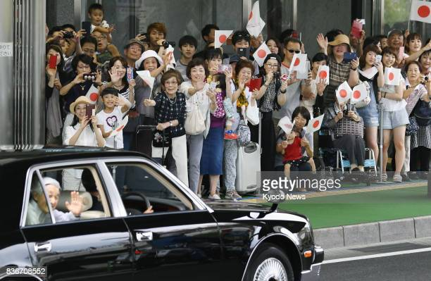 Local people welcome Japanese Emperor Akihito and Empress Michiko as they arrive at JR Karuizawa Station in Nagano Prefecture central Japan on Aug 22...