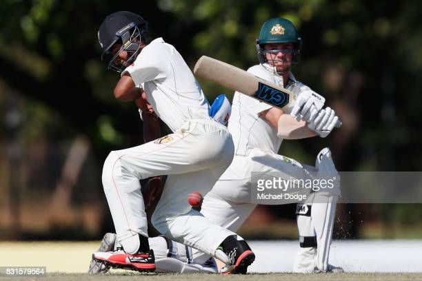 Local player Adi Dave is hit by Travis Head during day two of the Australian Test cricket intersquad match at Marrara Cricket Ground on August 15...