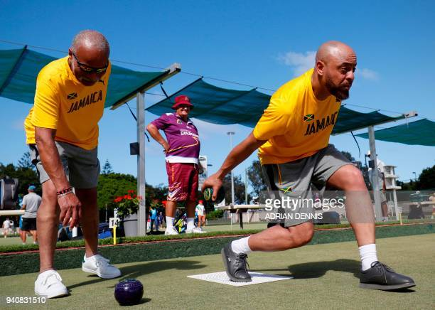 TOPSHOT A local player looks on as Jamaica's lawn bowls players Andrew Newell and Melvyn Edwards practice at the Southport Bowls Club ahead of the...
