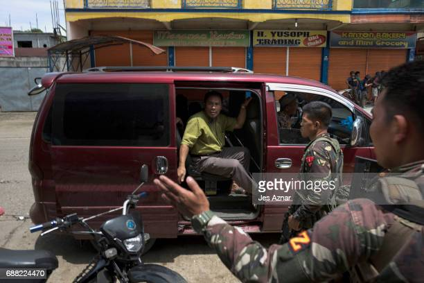Local police and soldiers screen vehicles and traffic in the streets going out of the city for escaping militants on May 25 2017 in Marawi city...