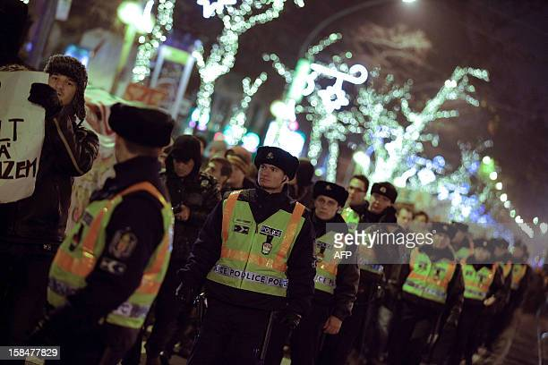 Local police follow demonstrators made up of university students teachers doctors and artists sduring an antigovernment protest in central Budapest...