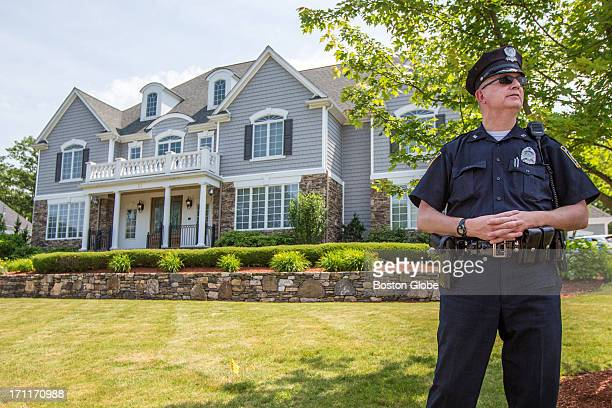 Local police officer stood outside the home of New England Patriots player Aaron Hernandez in North Attleborough. Hernandez has been linked to the...